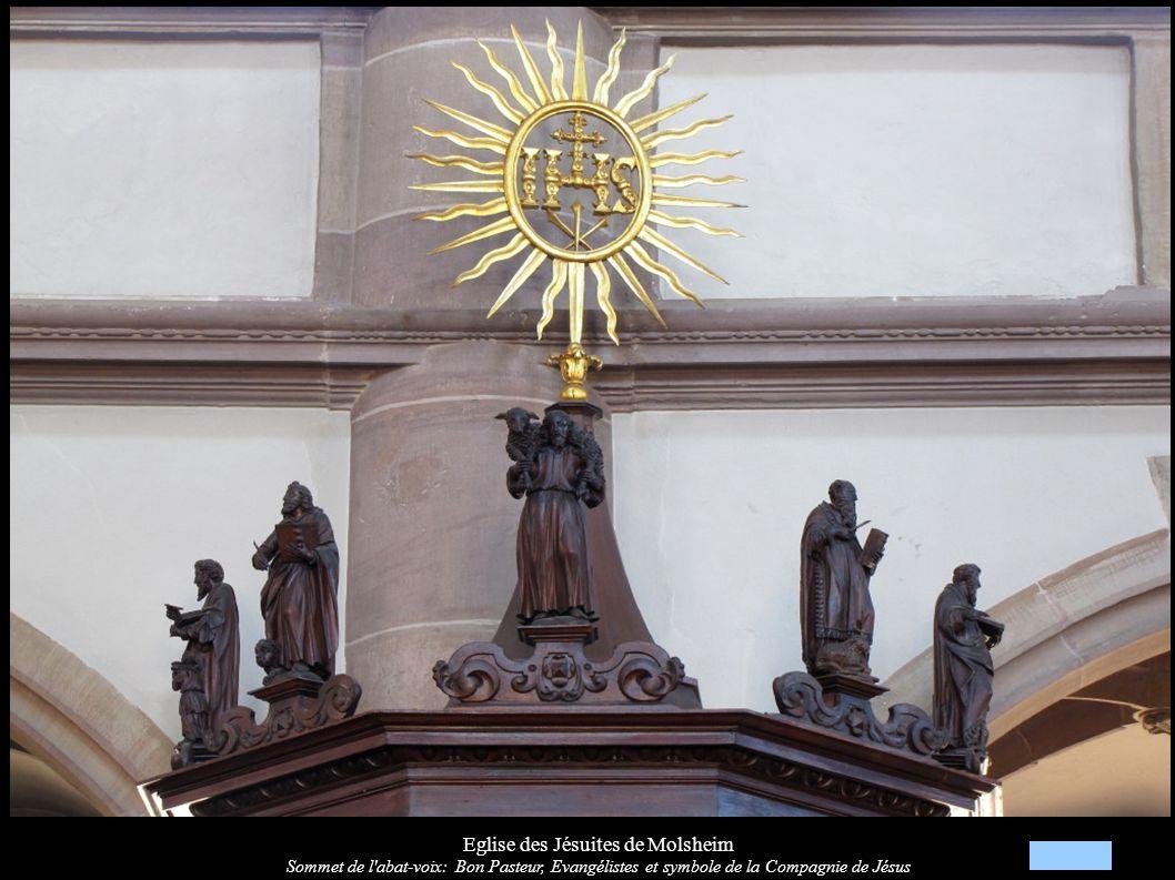Eglise des Jésuites de Molsheim Sommet de l'abat-voix: Bon Pasteur, Evangélistes et symbole de la Compagnie de Jésus