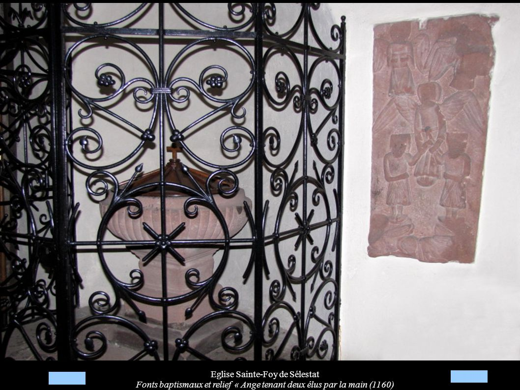 Eglise Sainte-Foy de Sélestat Fonts baptismaux et relief « Ange tenant deux élus par la main (1160)