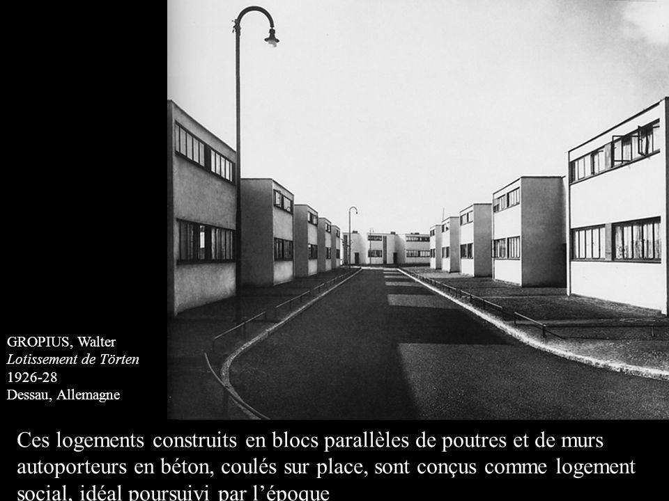 GROPIUS, Walter Lotissement de Törten 1926-28 Dessau, Allemagne Ces logements construits en blocs parallèles de poutres et de murs autoporteurs en bét