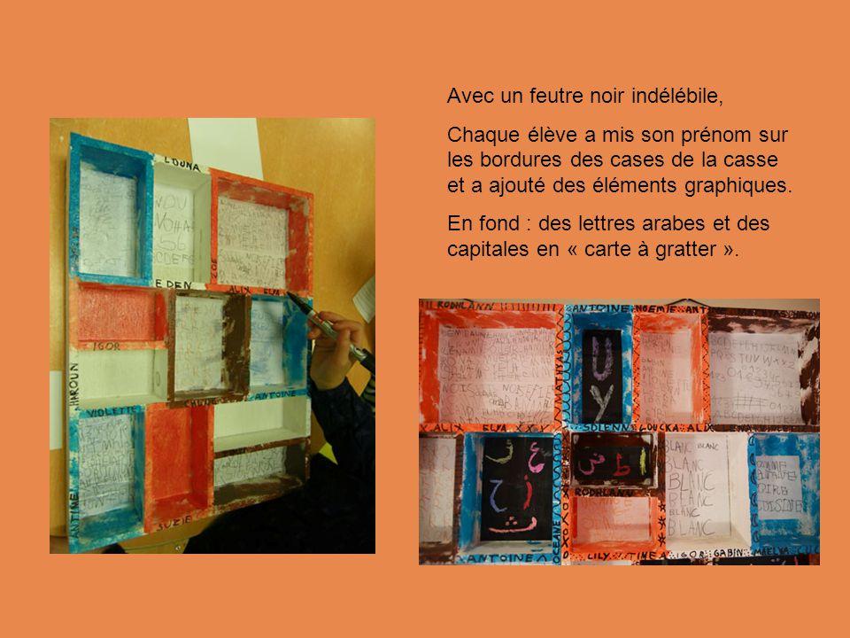 Avec un feutre noir indélébile, Chaque élève a mis son prénom sur les bordures des cases de la casse et a ajouté des éléments graphiques.