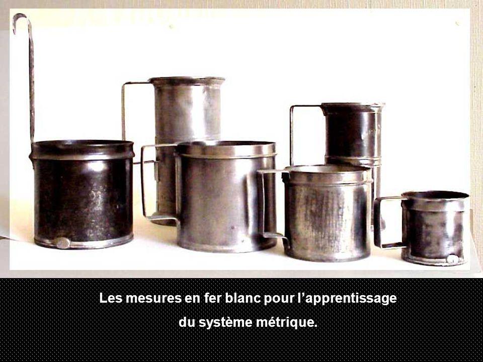 Les mesures en fer blanc pour l'apprentissage du système métrique.