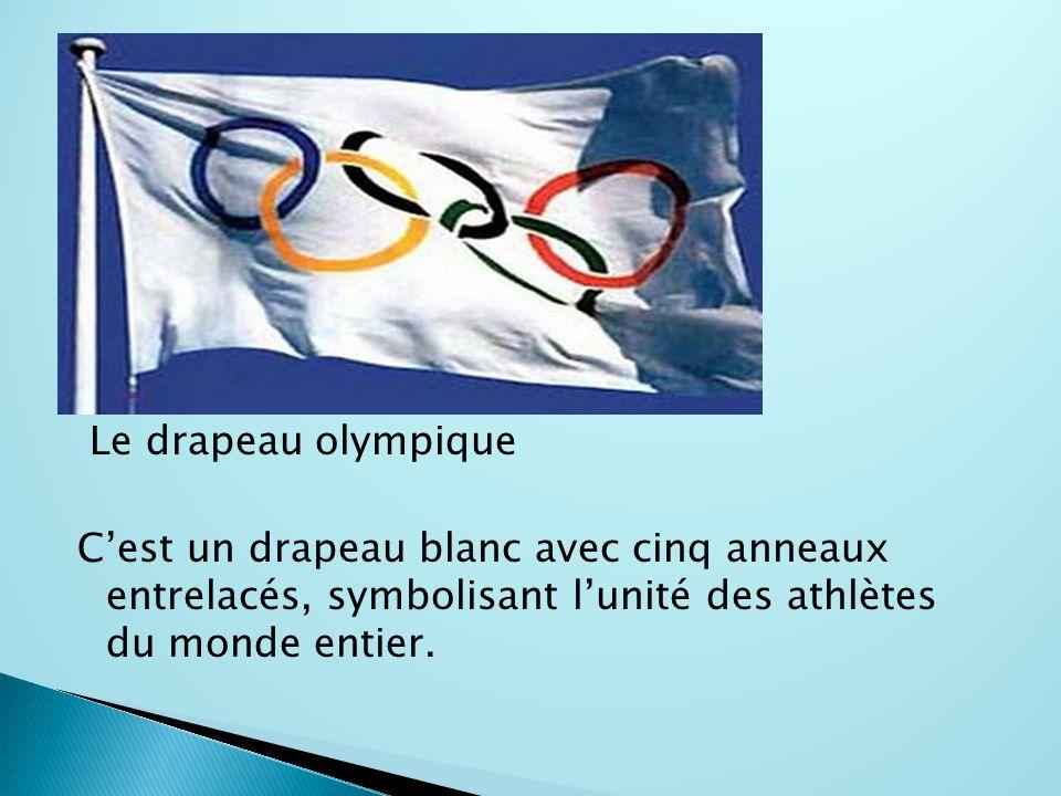 Le drapeau olympique C'est un drapeau blanc avec cinq anneaux entrelacés, symbolisant l'unité des athlètes du monde entier.