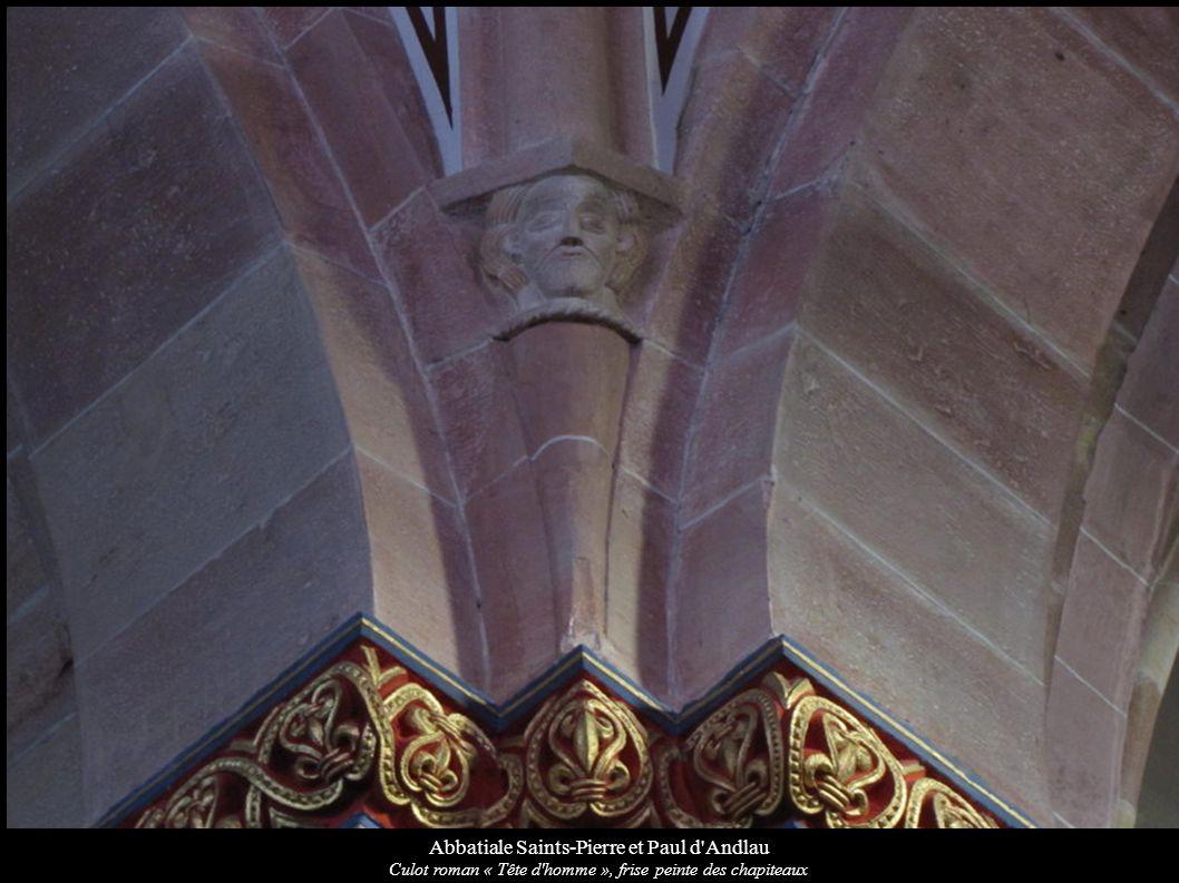 Abbatiale Saints-Pierre et Paul d'Andlau Culot roman « Tête d'homme », frise peinte des chapiteaux
