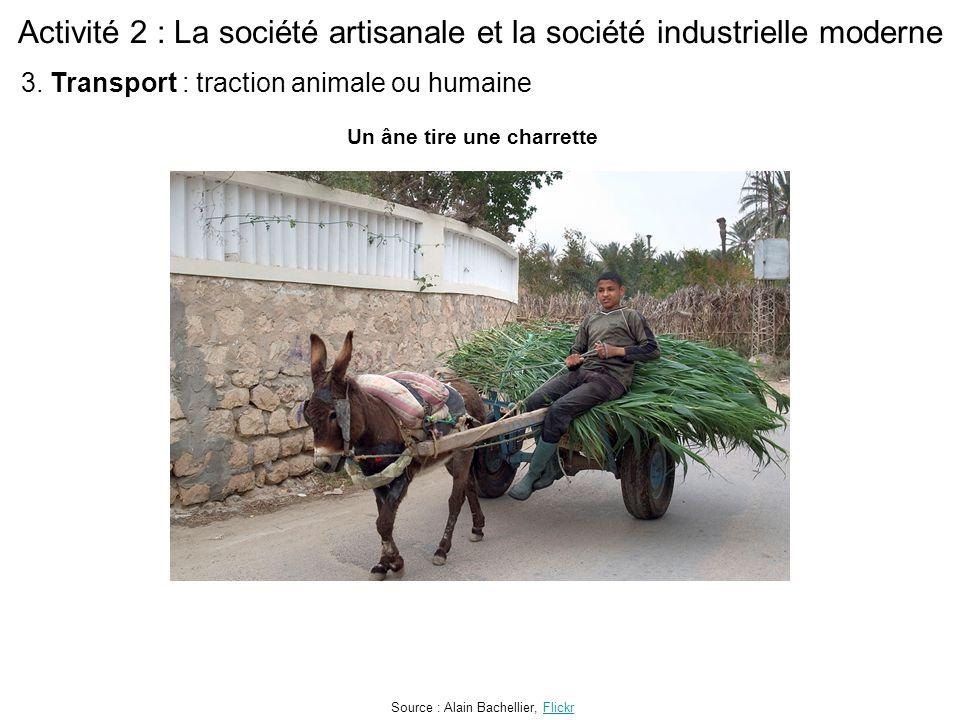 Activité 2 : La société artisanale et la société industrielle moderne Un âne tire une charrette Source : Alain Bachellier, FlickrFlickr 3. Transport :