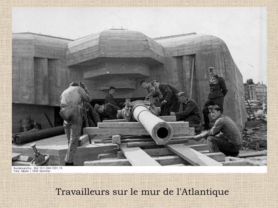 Travailleurs sur le mur de l Atlantique