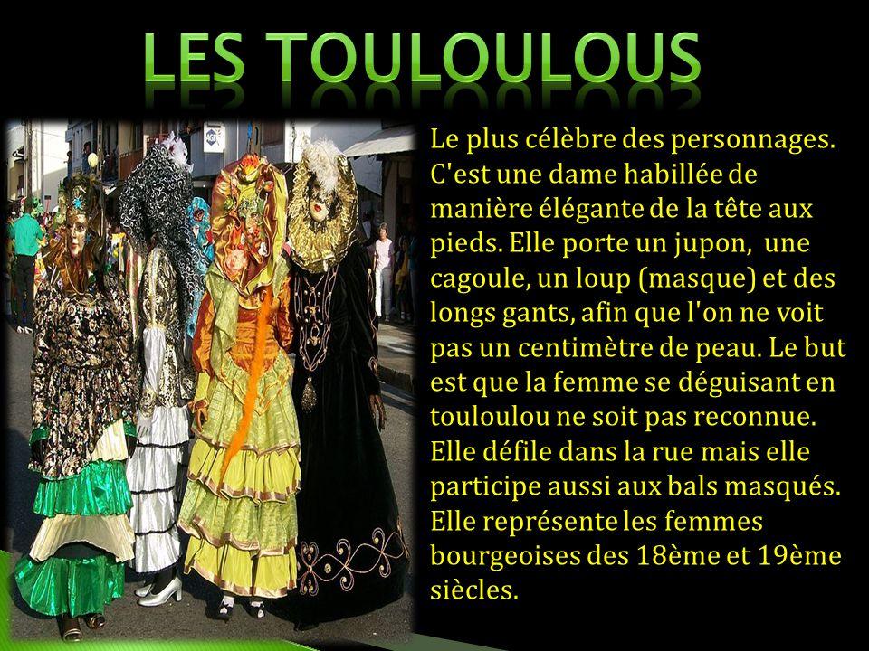 Le plus célèbre des personnages. C'est une dame habillée de manière élégante de la tête aux pieds. Elle porte un jupon, une cagoule, un loup (masque)