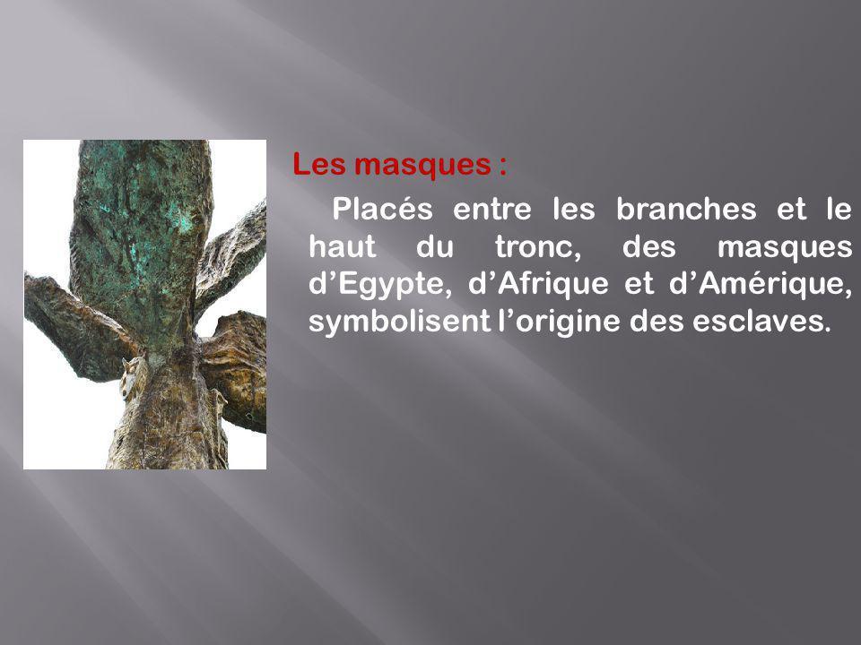 Les masques : Placés entre les branches et le haut du tronc, des masques d'Egypte, d'Afrique et d'Amérique, symbolisent l'origine des esclaves.