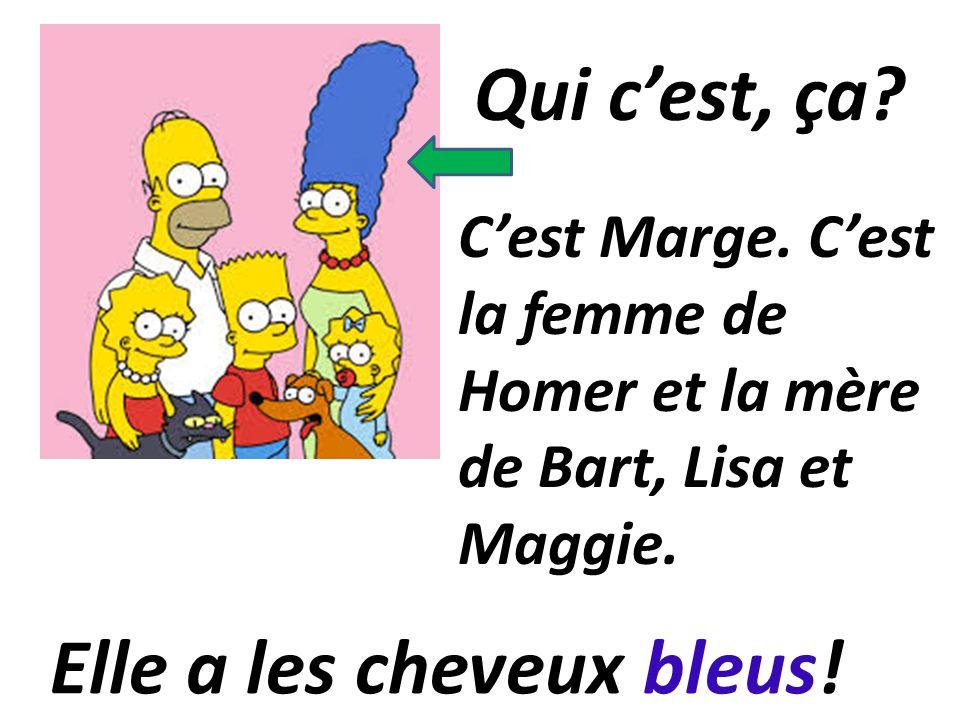 C'est Marge.C'est la femme de Homer et la mère de Bart, Lisa et Maggie.