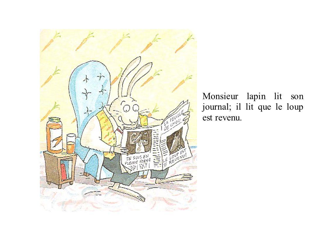 Monsieur lapin lit son journal; il lit que le loup est revenu.