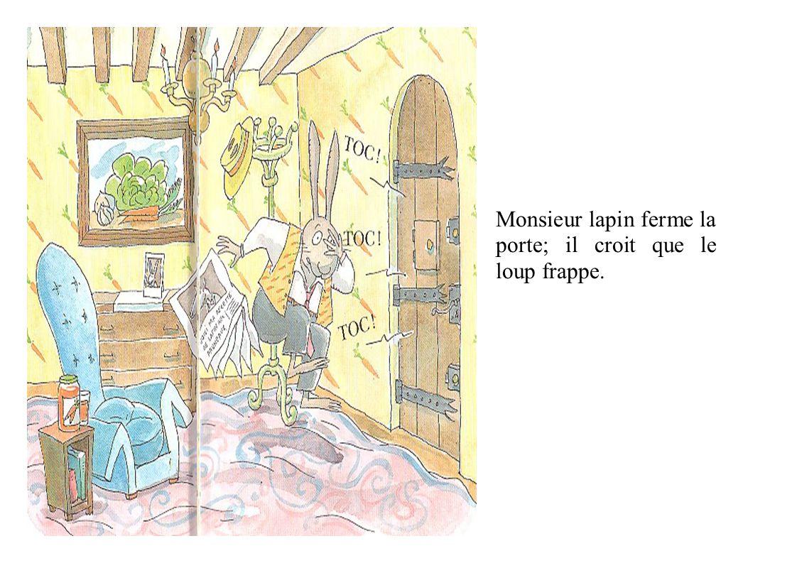 Monsieur lapin ferme la porte; il croit que le loup frappe.