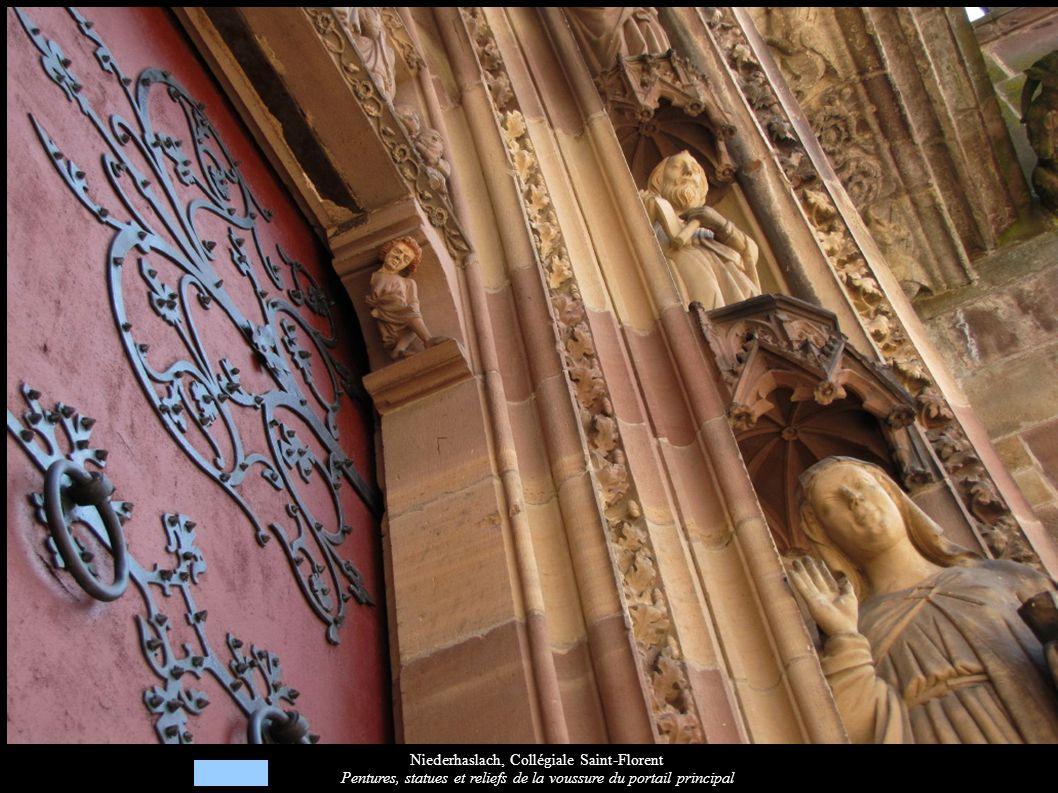 Niederhaslach, Collégiale Saint-Florent Pentures, statues et reliefs de la voussure du portail principal