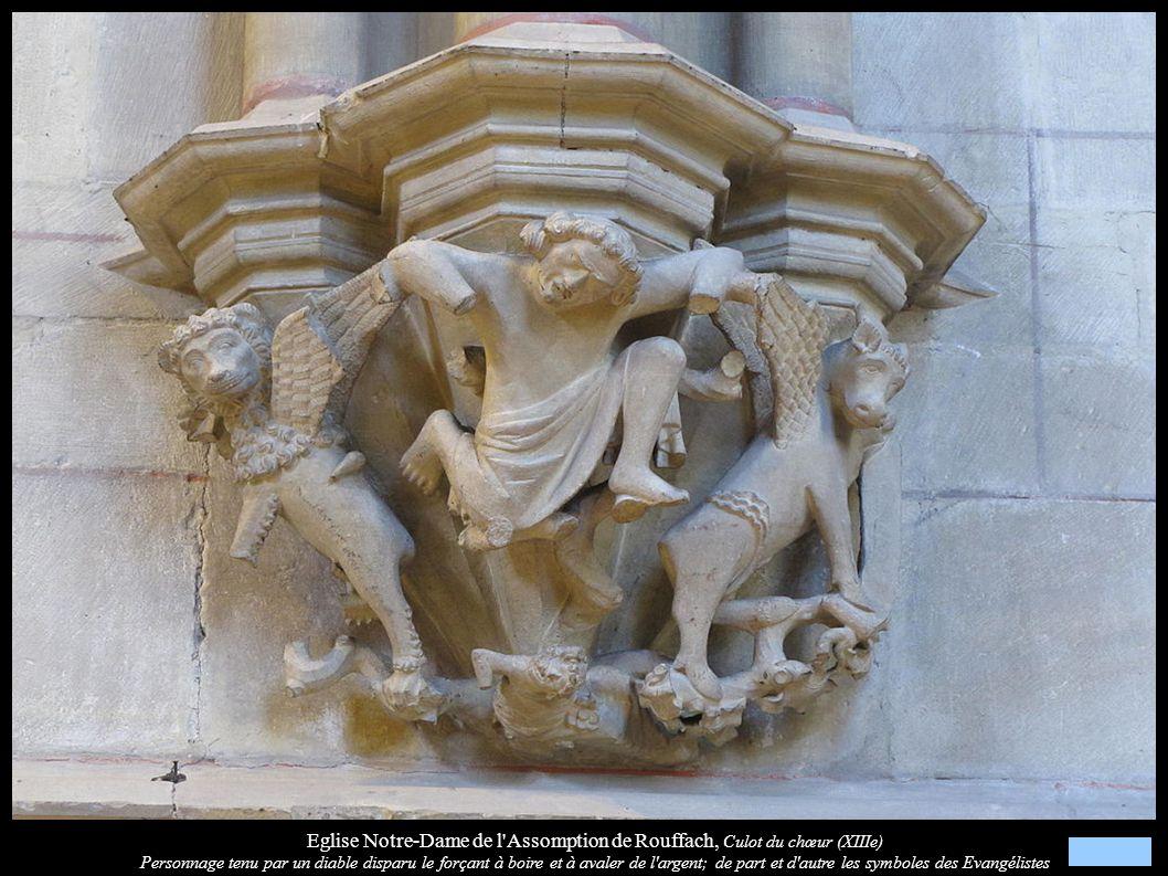 Eglise Notre-Dame de l'Assomption de Rouffach, Culot du chœur (XIIIe) Personnage tenu par un diable disparu le forçant à boire et à avaler de l'argent