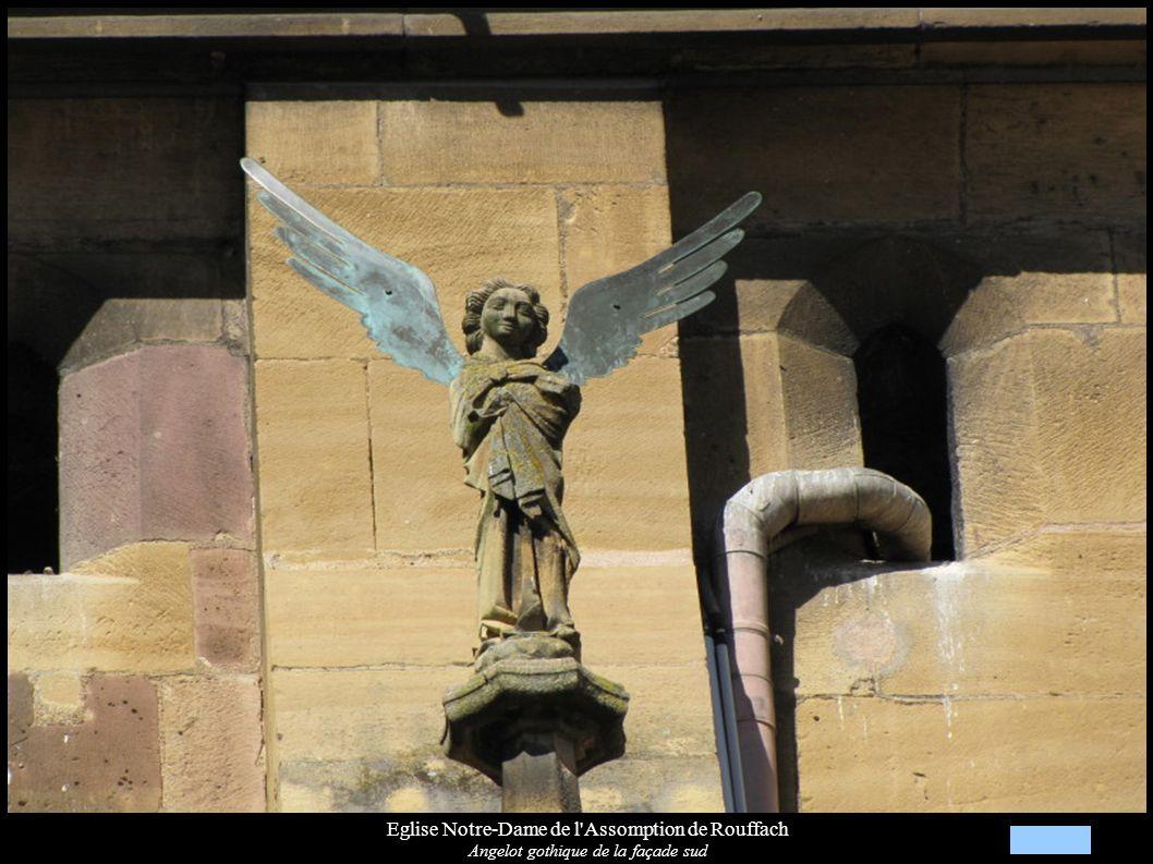 Eglise Notre-Dame de l Assomption de Rouffach, Culot du chœur (XIIIe) Personnage tenu par un diable le forçant à boire et à avaler de l argent; de part et d autre les symboles des Evangélistes