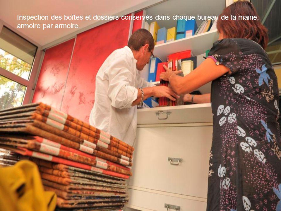 Inspection des boîtes et dossiers conservés dans chaque bureau de la mairie, armoire par armoire.