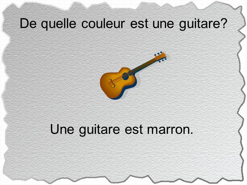 De quelle couleur est une guitare Une guitare est marron.