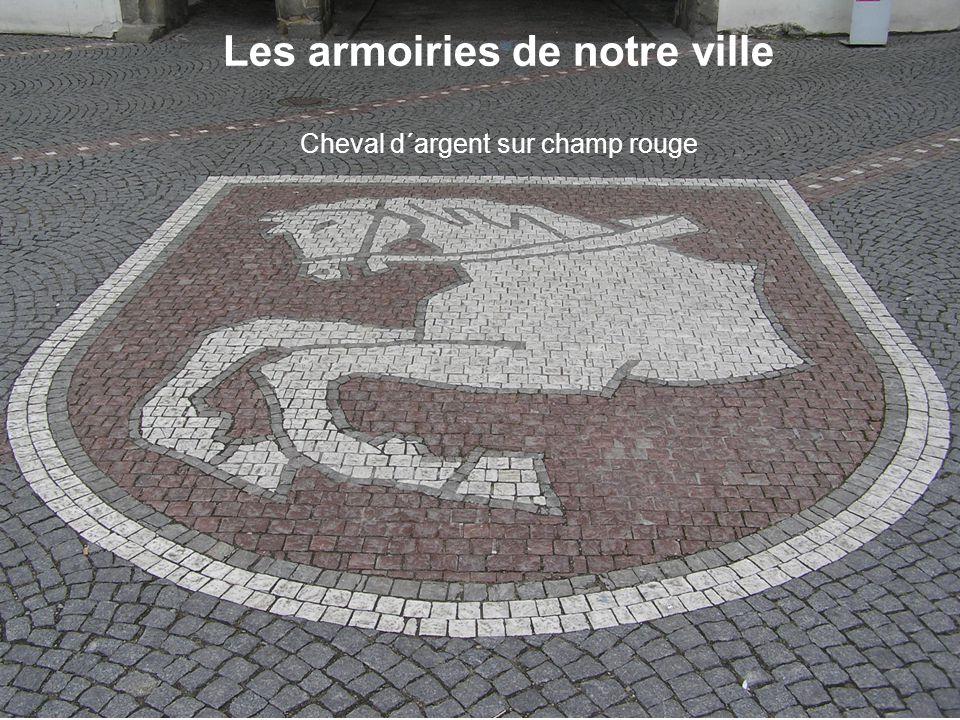 Les armoiries de notre ville Cheval d´argent sur champ rouge