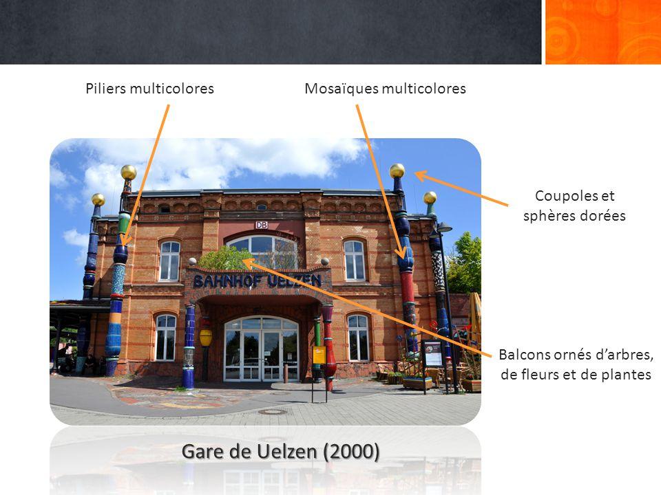 Piliers multicoloresMosaïques multicolores Balcons ornés d'arbres, de fleurs et de plantes Coupoles et sphères dorées Gare de Uelzen (2000)