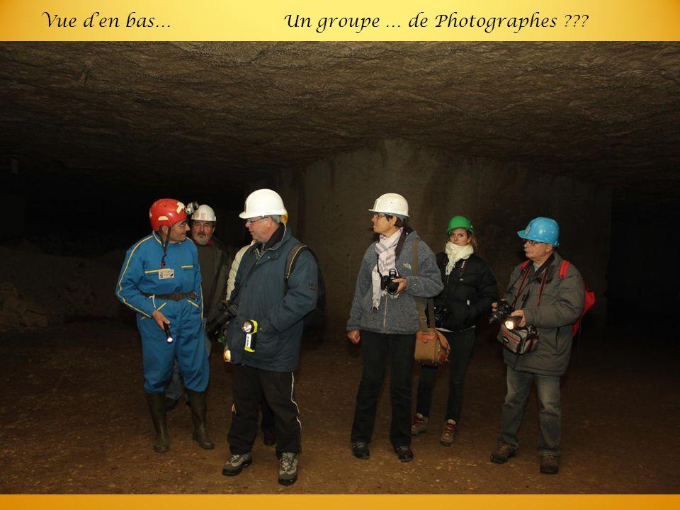 Vue d'en bas…Un groupe … de Photographes