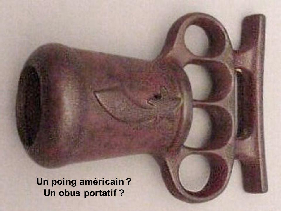 Un poing américain ? Un obus portatif ?