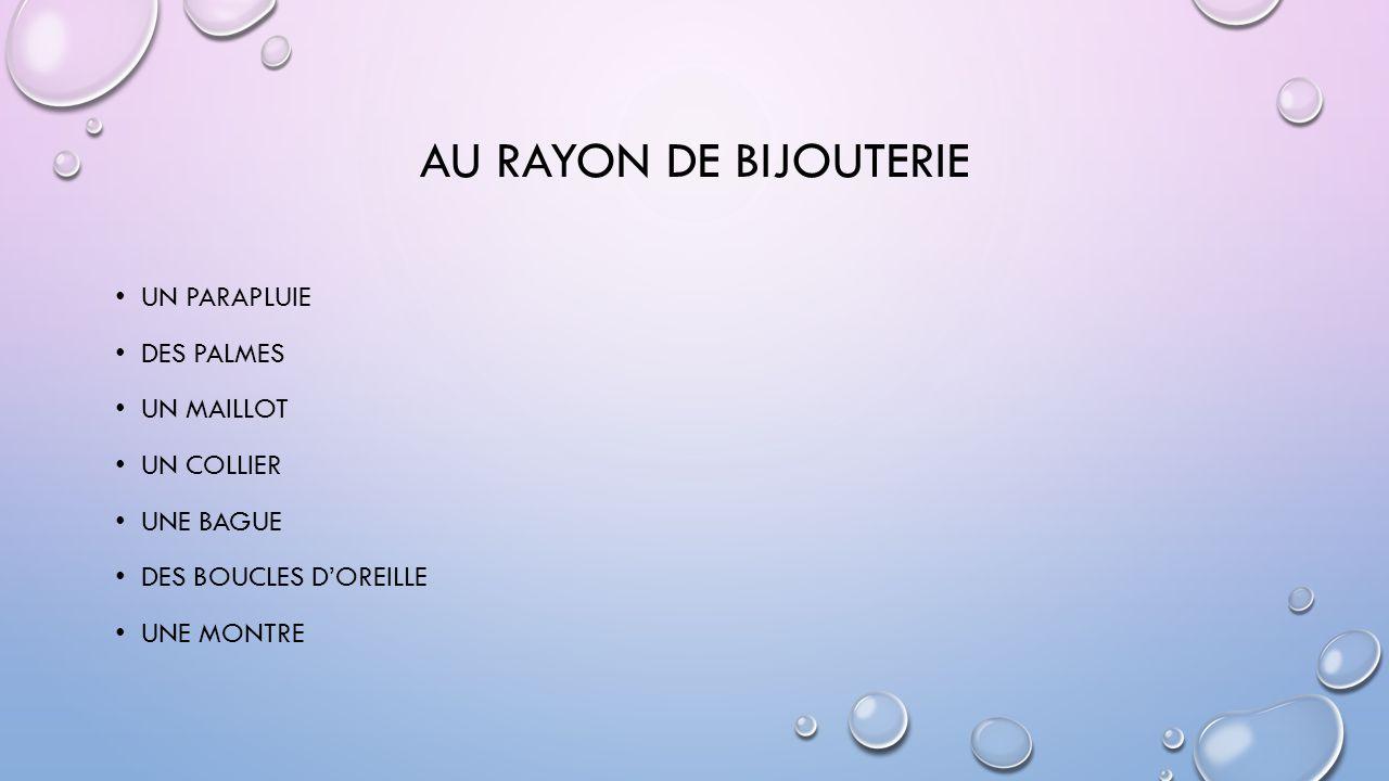 AU RAYON DE BIJOUTERIE UN PARAPLUIE DES PALMES UN MAILLOT UN COLLIER UNE BAGUE DES BOUCLES D'OREILLE UNE MONTRE