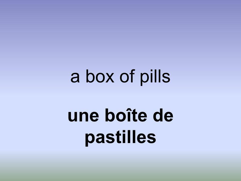 a box of pills une boîte de pastilles