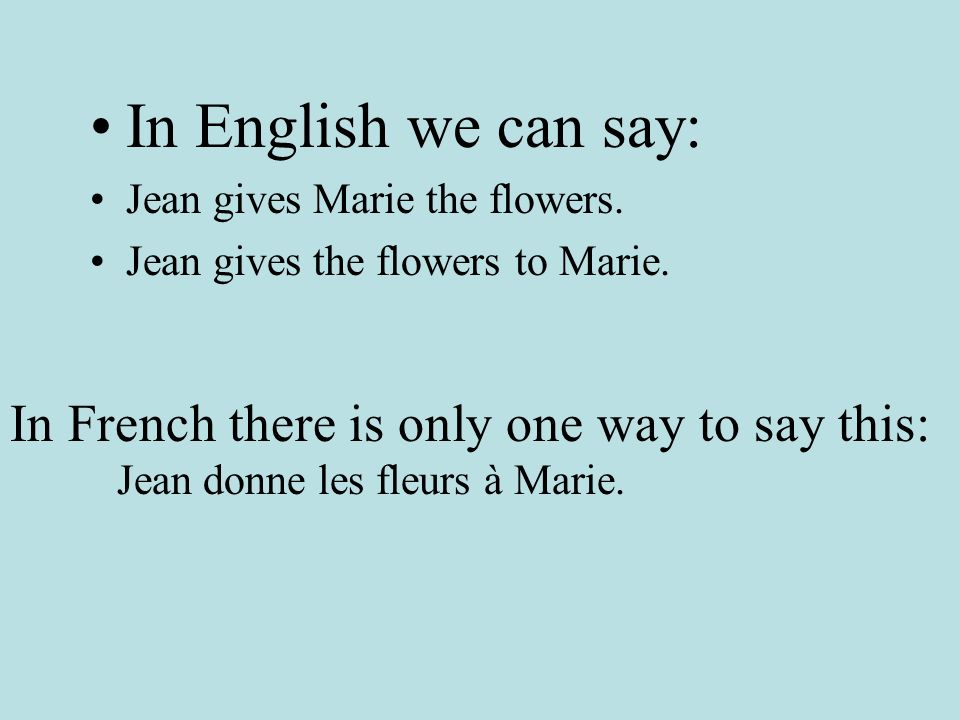 In English we can say: Jean gives Marie the flowers.